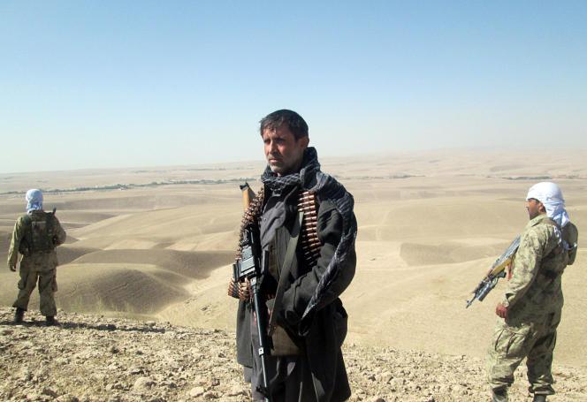 Le 1er octobre, des membres des forces de sécurité afghanes et des miliciens s'apprêtent à rejoindre Kunduz pour se battre contre les talibans, qui ont pris le contrôle de la ville l'avant-veille.