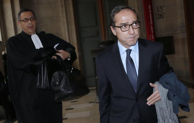 L'ancien conseiller de François Hollande Faouzi Lamdaoui (à droite), le 5 octobre 2015 au palais de justice de Paris pour son procès en première instance.