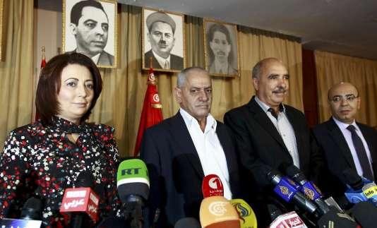 Wided Bouchamaoui (UTIC, patronat), Houcine Abassi (UGTT, syndicat), Abdessatar ben Moussa (Ligue des droits de l'homme) et Mohamed Fadhel Mahmoud (ordre des avocats), représentants des organisations membres du dialogue national tunisien, le 21 septembre 2013.