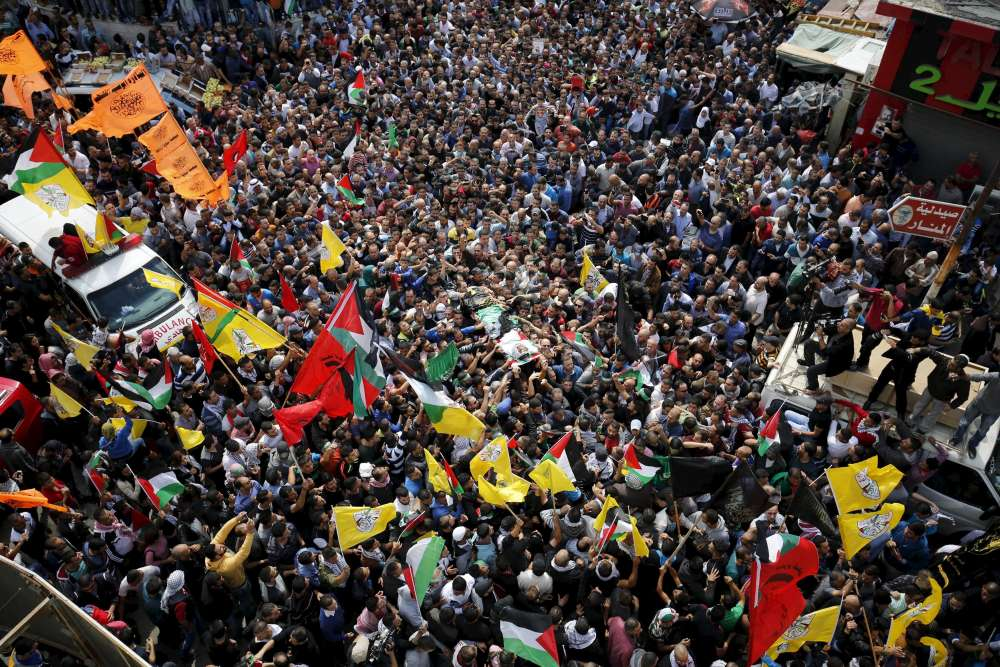 Autour de la dépouille du jeune homme flottaient les drapeaux du Jihad islamique, du Hamas, du Fatah, mais aussi du mouvement de gauche Initiative nationale palestinienne.