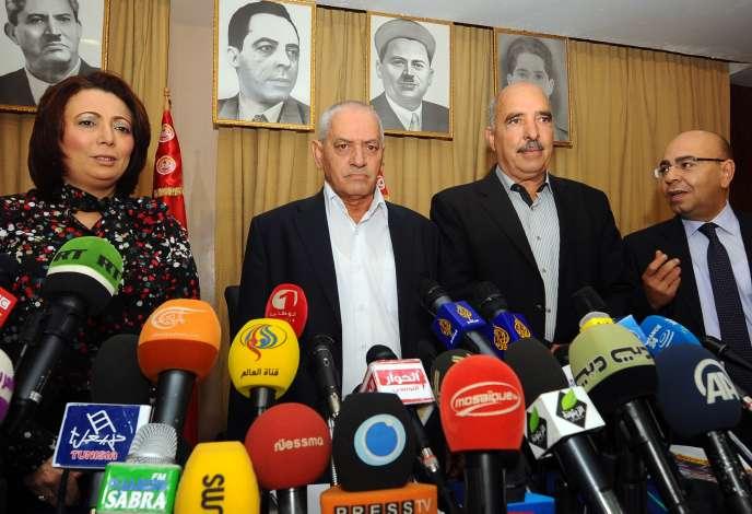 Wided Bouchamaoui (UTIC, patronat), Hocine Abassi (UGTT, syndicat), Abdessetar ben Moussa (Ligue des droits de l'homme) et Mohamed Fadhel Mahmoud (ordre des avocats), représentants des organisations membres du dialogue national tunisien le 21 septembre 2013.