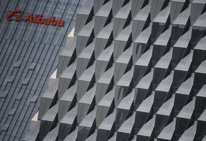 A logo of Alibaba Group is seen on a building under construction, where the company's Beijing headquarters will be, in Beijing, China, October 15, 2015. Chinese e-commerce giant Alibaba Group Holding Ltd is lobbying hard to stay off the U.S. Trade Representative's blacklist after coming under renewed pressure this year over suspected counterfeits sold on its shopping platforms. Picture taken October 15, 2015.  REUTERS/Kim Kyung-Hoon