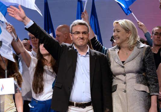 Aymeric Chauprade en compagnie de la présidente du FN, lors de la campagne pour les élections européennes, le 18 mai 2014.