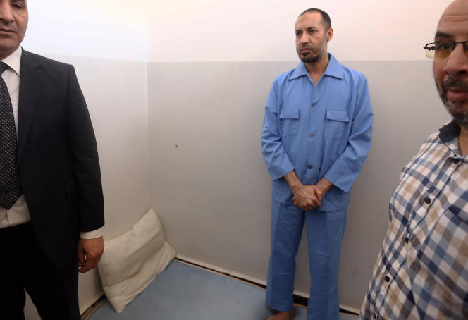 Saadi Kadhafi (center), son of former Libyan leader Muammar Kadhafi, in Al-Hadba prison in the capital, Tripoli, on August 10, 2015.
