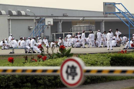 Les débrayages de travailleurs se sont multipliés ces dernières années dans les usines de l'est chinois (Photo: ouvriers grévistes devant l'usine Honda de Foshan (Guangdong), le 27 mai 2010).