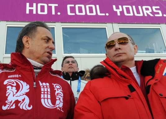 Vladimir Poutine et le ministre russe des sports, Vitaly Mutko, le 16 février 2014 à Sotchi.