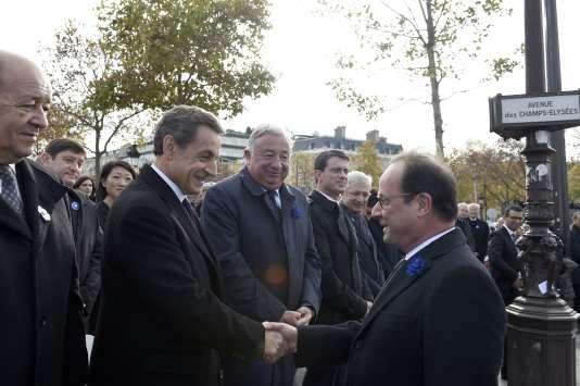 Francois Hollande et Nicolas Sarkozy, le 11 novembre. AFP PHOTO/POOL/ERIC FEFERBERG