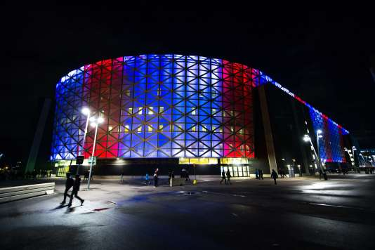 The Friends arena in Solna near Stockholm is lit with national colours of France ahead the Euro 2016 play-off football match between Sweden and Denmark on November 14, 2015. AFP PHOTO / JONATHAN NACKSTRAND