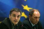 Greece's Finance Minister Euclid Tsakalotos, left, speaks during a news conference as Economy Minister Giorgos Sathakis listens, in Athens on Tuesday, Nov. 17, 2015. Greece reached an agreement with European creditors Tuesday on economic measures it needs to introduce so it can get its next batch of bailout money, including a 10 billion-euro ($10.7 billion) cash injection for its crippled banks. (AP Photo/Petros Giannakouris)