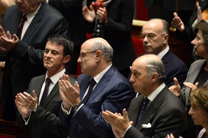 Manuel Valls, Jean-Marie Le Guen, Laurent Fabius et Bernard Cazeneuve (au second plan), à l'Assemblée nationale, le 18 novembre.