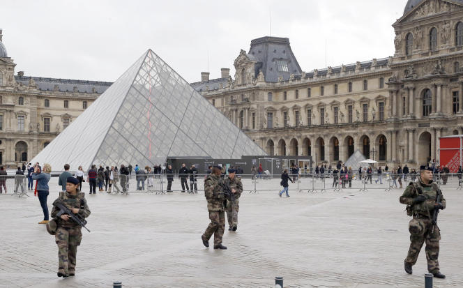 Soldiers patrol in the courtyard of the Louvre museum in Paris, Thursday, Nov.19, 2015. The Belgian extremist suspected of masterminding the deadly attacks in Paris died a day ago along with his female cousin in a police raid on a suburban apartment building, French officials said Thursday, adding it was still not clear exactly how he died. (AP Photo/Jacques Brinon)