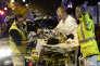 Des personnels du Smur évacuent un blessé aux abords du Bataclan, à Paris, dans la nuit du 13 au 14 novembre.
