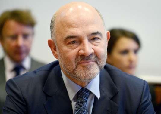 « Si nous n'arrivons pas à nous entendre à 11, comment le ferons-nous à 28 ? », a relevé Pierre Moscovici, commissaire européen à l'économie, à propos de la taxe sur les transactions financières. AFP PHOTO / ERIC PIERMONT