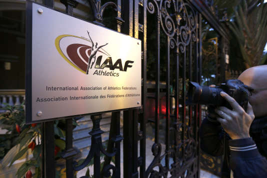 FILE - In this Nov.13, 2015 file photo, a photographer pictures the logo at the IAAF (International Amateur Athletic Federation) headquarters in Monaco. A step-by-step anti-doping roadmap that Russia will have to follow to be allowed back into international competition is to be discussed Thursday by track and field's governing body. The meeting in Monaco of the IAAF council could throw up difficult questions for its president, Sebastian Coe. (AP Photo/Lionel Cironneau, File)