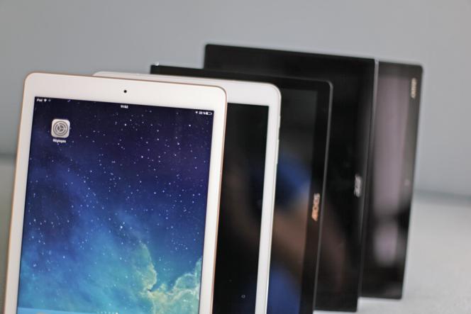 Un iPad Air 2 suivi des tablettes Android que la vision d'Apple a inspirées.