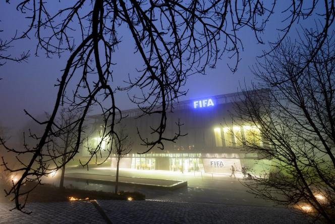 The FIFA headquarters are seen engulfed by fog on December 3, 2015 in Zurich.  The multi-million dollar corruption scandal engulfing FIFA widened on December 3.