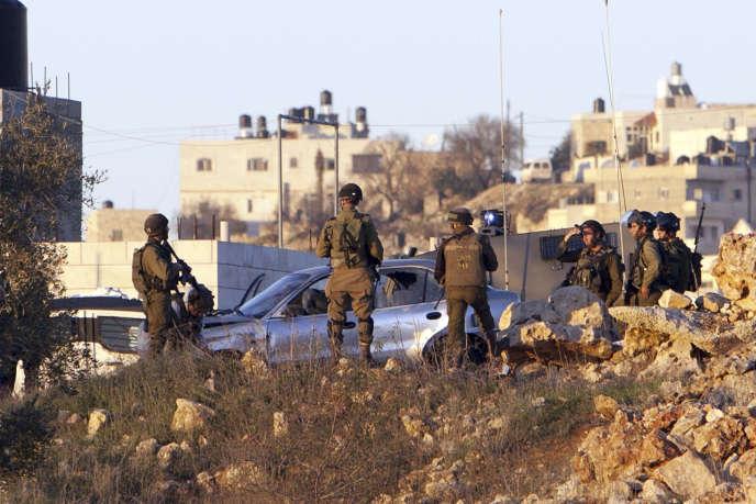 Des soldats israéliens à Silwad le 4 décembre, après une nouvelle tentative d'attaque à la voiture bélier.
