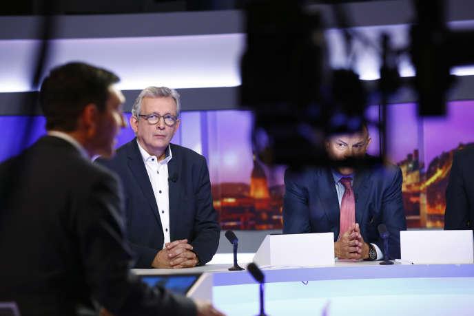 Pierre Laurent (PCF) et Jean-Marie Le Guen (PS), sur le plateau de TF1, le 6 décembre.