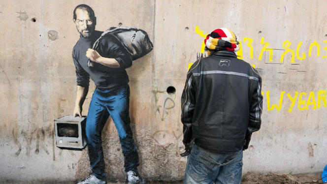 Une des oeuvres réalisées par Banksy à Calais, représentant Steve Jobs, ancien patron d'Apple.