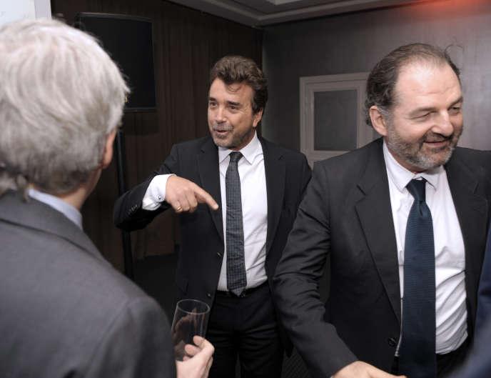Le PDG de Lagardère Active, Denis Olivennes, et Arnaud Lagardère, en mars 2014 à Paris.