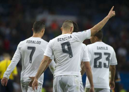 Real Madrid's French forward Karim Benzema (C) celebrates after scoring during the Spanish league football match Real Madrid CF vs Rayo Vallecano de Madrid at the Santiago Bernabeu stadium in Madrid on December 20, 2015. Real Madrid won 10-2.   AFP PHOTO/ CURTO DE LA TORRE