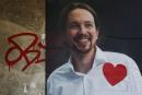 A red heart is pasted on a poster of Podemos (We Can) party leader Pablo Iglesias a day after the most fragmented national election result in Spain's history in Madrid, Spain, December 21, 2015. REUTERS/Susana Vera