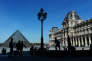 FILE - In this April 14, 2015 file photo, tourists walk in the courtyard of the Louvre museum, in Paris, France. Paris tourism took a hit in the weeks following the Nov. 13 terror attacks with a 12 percent drop in hotel occupancy and declines in air bookings for future arrivals.  (AP Photo/Thibault Camus, File)