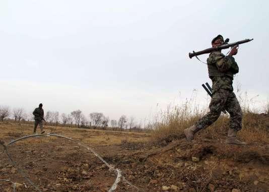 Un soldat  afghan lors d'une opération contre les talibans dans la province du Helmand, en décembre.