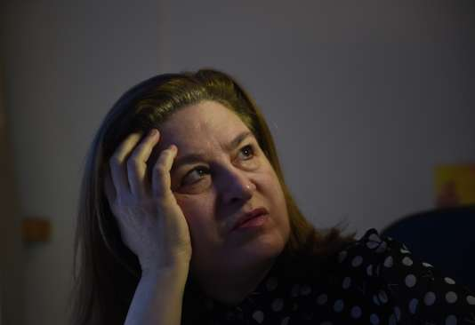 Ursula Gauthier, the Beijing-based correspondent for French news magazine L'Obs, looks on during an interview in her apartment in Beijing on December 28, 2015.