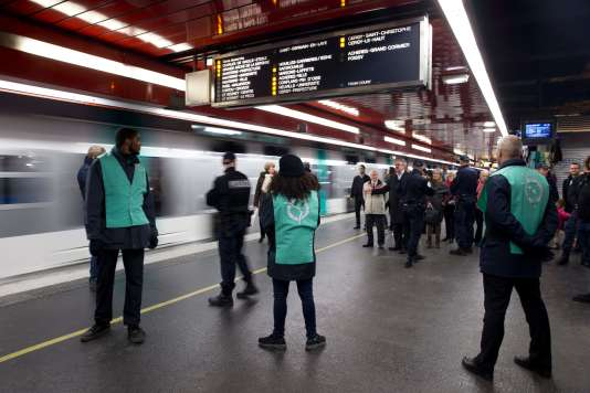 A picture taken on December 30, 2015 shows members of the RATP security at the RER Auber station in Paris.   / AFP / KENZO TRIBOUILLARD