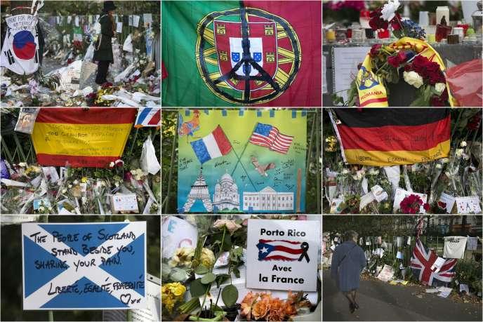 Des drapeaux étrangers au mémorial improvisé en souvenir des attentats de Paris devant le Bataclan à Paris.