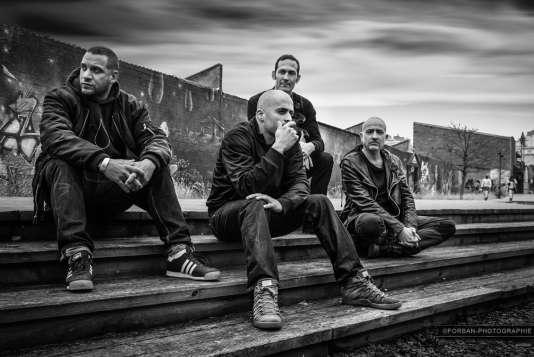 Le groupe Zone Libre PolyUrbaine. De gauche à droite, Mike Ladd, Marc Nammour, Cyril Bilbeaud et Serge Teyssot-Gay.