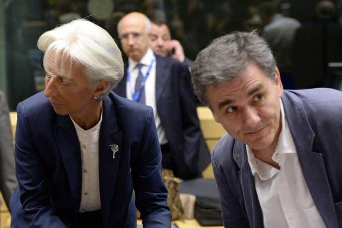Le ministre des finances grec, Euclide Tsakalotos, et la directrice générale du FMI, Christine Lagarde, en juillet à Bruxelles à l'occasion d'un Eurogroupe