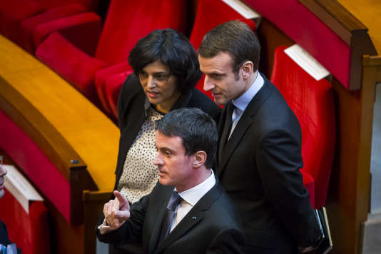 Manuel Valls, Myriam El Khomri et Emmanuel Macron pendant la cérémonie des voeux aux acteurs de l'entreprise et de l'emploi, au Conseil Economique Social et Environnemental à Paris, lundi 18 janvier 2016.