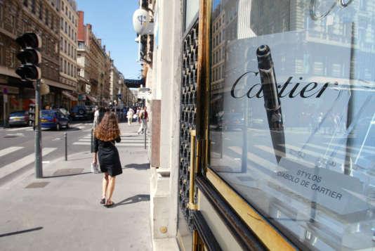 Boutiques de luxe rue Edouard-Herriot, à Lyon. JEAN-PHILIPPE KSIAZEK / AFP