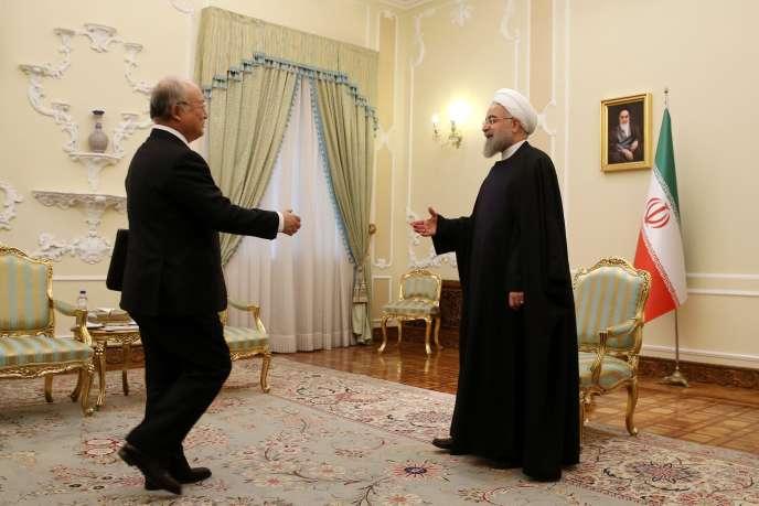 Hassan Rohani (à droite) accueille le directeur de l'Agence internationale de l'énergie atomique, le 18 janvier à Téhéran.
