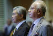 Malaysian Prime Minister Najib Razak, right, with Deputy Prime Minister Ahmad Zahid Hamidi stands for the national anthem during a special announcement on the budget revision at the Putrajaya International Convention Center outside Kuala Lumpur, Malaysia, Thursday, Jan. 28, 2016. Najib said the government had based the 2016 budget on oil prices averaging $48 a barrel, but that estimate has been lowered to $30-$35 a barrel. He said the government loses around 300 million ringgit ($70 million) for every $1 drop in oil prices. (AP Photo/Joshua Paul)