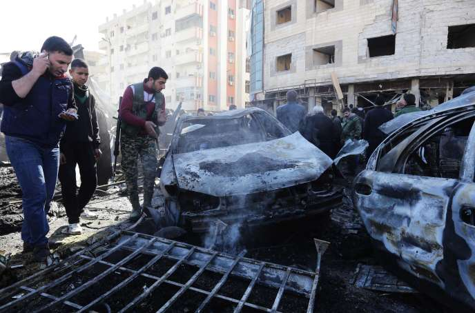 Syrian pro-government forces and residents gather at the site of suicide bombings in the area of a revered Shiite shrine in the town of Sayyida Zeinab, on the outskirts of the capital Damascus, on January 31, 2016. The Islamic State group claimed responsibility for the bombings that killed at least 45 people. / AFP / LOUAI BESHARA