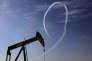 Deux géants ont publié, mardi 2 février, de mauvais résultats pour l'exercice 2015 : l'américain ExxonMobil et le britannique BP. (AP Photo/Hasan Jamali, File)