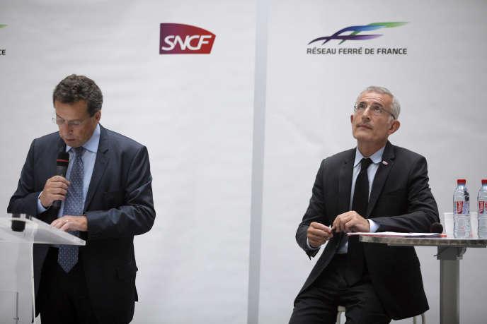 Jacques Rapoport, président de SNCF Réseau (à gauche), et Guillaume Pepy, président de SNCF Mobilités, le 7 juillet 2014, à Paris.