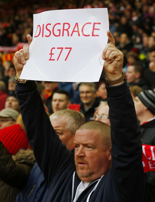 A Liverpool fan holds a banner protesting against the recently announced rise in ticket prices during the English Premier League football match between Liverpool and Sunderland at Anfield in Liverpool, northwest England, on February 6, 2016. RESTRICTED TO EDITORIAL USE. No use with unauthorized audio, video, data, fixture lists, club/league logos or 'live' services. Online in-match use limited to 75 images, no video emulation. No use in betting, games or single club/league/player publications.   / AFP / LINDSEY PARNABY / RESTRICTED TO EDITORIAL USE. No use with unauthorized audio, video, data, fixture lists, club/league logos or 'live' services. Online in-match use limited to 75 images, no video emulation. No use in betting, games or single club/league/player publications.