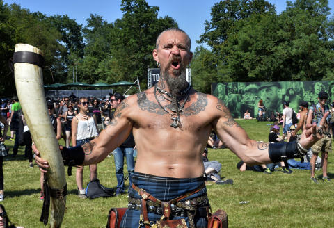 Heavy metal fans gesture during the Hellfest heavy metal and hard rock music festival Hellfest in Clisson, near Nantes, western France, on June 19, 2015. AFP PHOTO GEORGES GOBET / AFP / GEORGES GOBET