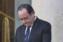 France's President Francois Hollande folds his hands after a meeting with Zambia's President Edgar Chagwa Lunguat the Elysee Palace in Paris, Monday, Feb. 8, 2016. Zambia's President Edgar Chagwa Lungu is for a three days visit in France. (AP Photo/Michel Euler)