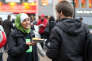 "A member (L) of the Collective against Islamophobia in France (CCIF) distributes French pastries, called ""pain au chocolat,"" in front of the Saint-Lazare railway station on October 10, 2012 in Paris to protest against the October 5 remarks made by the  general secretary of the rightist French Union for a Popular Movement (UMP) party, Jean-Francois Cope,  to UMP supporters in Draguignan about a boy who allegedly had his ""pain au chocolat"" stolen by ""thugs"" during the fasting month of Ramadan. AFP PHOTO / THOMAS SAMSON / AFP / THOMAS SAMSON"