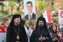 Des prêtres orthodoxes attendent l'arrivée du patriarche Cyrille à Damas, le 12 novembre 2011.