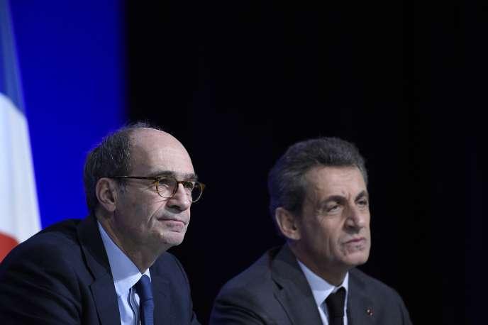 Eric Woerth et Nicolas Sarkozy, respectivement secrétaire général et président desRépublicains, le 13février, lors d'un conseil national.