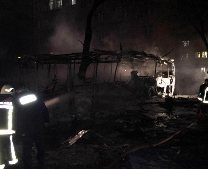 A burning car seen after an explosion in Ankara, Turkey, Wednesday, Feb. 17, 2016. Assailants on Wednesday exploded a car bomb near vehicles carrying military personnel in the Turkish capital, killing at least 18 people and wounding some 45 others, officials said. (AP Photo)