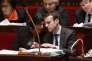 Myriam El Khomri, ministre du travail, et Emmanuel Macron, ministre de l'économie, le 26 janvier 2016 à l'Assemblée nationale. AFP PHOTO / THOMAS SAMSON