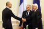 Le premier ministre ukrainien Arseni Iatseniouk reçoit les ministres des affaires étrangères français et allemand, Jean-Marc Ayrault et Frank-Walter Steinmeier, à Kiev, le 22 février.