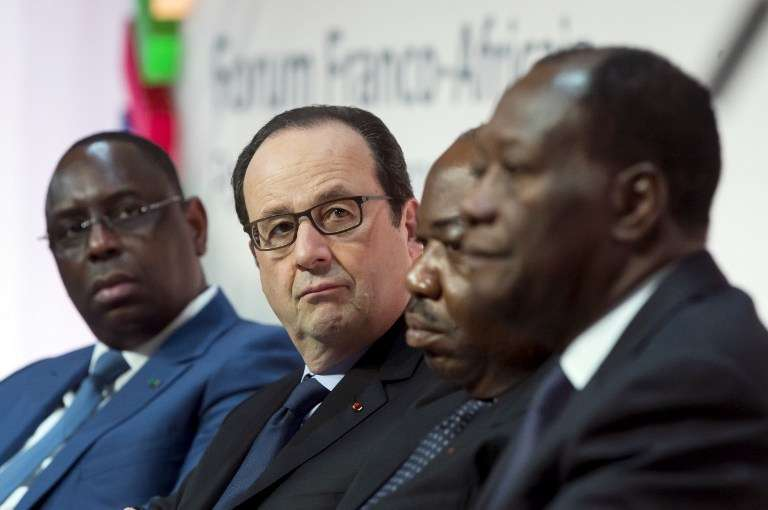 De gauche à droite : Macky sall, président du Sénégal, François Hollande, Ali Bongo, président du Gabon et Alassane Ouattara, président de la Côte d'Ivoire, le 6 février 2015 à Paris.